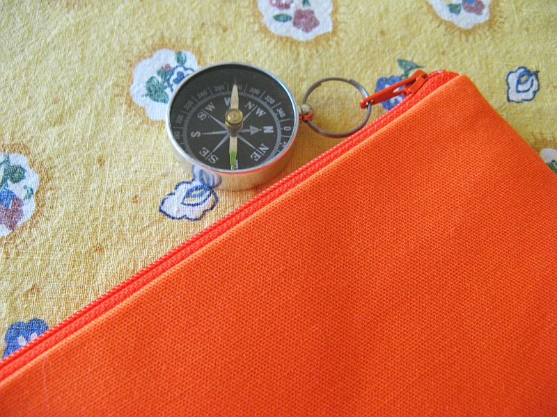 Orienteering bag with compass zipper pull