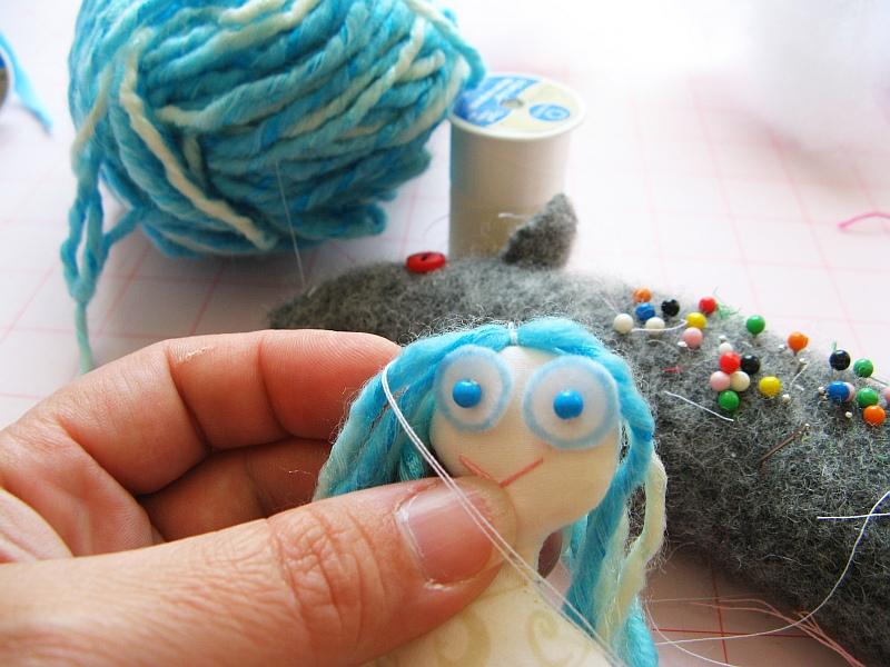 Sew hair to Mermaid head