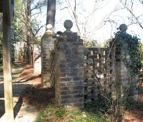 Massee Lane Camellia Gardens brick fence corner and path