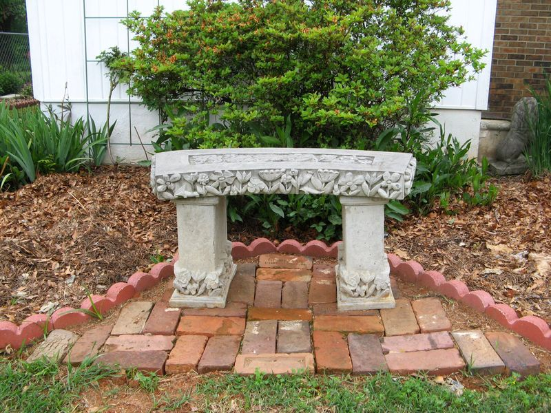 My Garden May 2013  back garden stone bench
